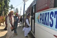 Ajrak patko boarding the bus decorated with Sindhi Ajrak, Karachi, Sindh 2015 (GlobalCitizen2011) Tags: karachi sind sindh topi sindhi 2015 patka ajrak patko sindhiculture sindhidress sindhcultureday sindhiclothes