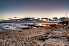 Pool in a pool of (artificial) light (JustAddVignette) Tags: australia beach clouds cloudysunrise early landscapes light newsouthwales northernbeaches ocean rockpool rocks sand seascape seawater sky southcurlcurl swimmer sydney water