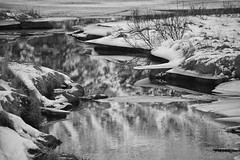 as the mountain stares at its reflection in an icy mirror (lunaryuna) Tags: iceland southwesticeland landscape skorradalsvatn lake river affluent ice water snow winter season seasonalwonders waterscape natureabstract beauty nature blackwhite bw monochrome lunaryuna
