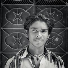 Seller (Fortunes2011. Closure of 6 years) Tags: man portrait portraiture boy closeup 11 5x5 square gate