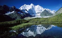 260109 () Tags: highest kangshungglacier landscape mountain mountchomolonzo peak pond reflection snow snowcovered tall tallest tibet water