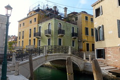 Colour by the bridge, Venice, October 2016. (Yekkes) Tags: europe italy venice city urban bridge canal green yellow paintedhouses balconies shutters water