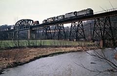 WM, Connellsville, Pennsylvania, 1975 (railphotoart) Tags: wb stillimage connellsville pennsylvania unitedstates wm westernmaryland viaduct bridge trestle 63 f7 emd 1975 nw norfolkandwestern train railroad fayettecounty