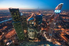 High Buildings (PhoenixRoofing164) Tags: sky sunrise city sunset street river travel buildings urban architecture roof cityscape building bright skyline skyscraper glass apartment стройка skyscrapers roofing городской пейзаж rooftop москва небоскребы моква сити вечерний вид