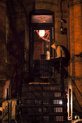 hostess perched on railing, Compass Rose, Washington, DC, USA (Plan R) Tags: restaurant outdoor brick compass rose washington dc night stairs leica m 240 noctilux