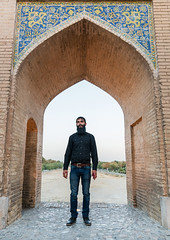 Man with a beard standing on khaju bridge pol-e khaju over dry zayandeh river, Isfahan province, Isfahan, Iran (Eric Lafforgue) Tags: 1people 30s adult adultsonly ancient architectural architecture attraction beard bridge building city colorimage cultural day dry esfahan fullframe fulllength hispahan iran iranian isfahan ispahan khajubridge landmark lookingatcamera middleeast onemanonly orient outdoors persia photography sepahan shahabbas stone stony tourism touristic traveldestinations unescoworldheritagesite urban vertical zayandeh isfahanprovince