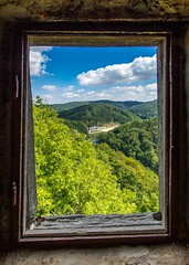 Through the window (crazy OFL) Tags: landscape travel color window frame trees contrast blue sky clouds