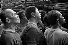 Hoping to catch a glimpse (Download this image free read below) (FotoGrazio) Tags: poverty old friends people blackandwhite man male men art feet boys contrast asian grey three pants legs skin sandals fineart philippines poor gray bald streetphotography highcontrast streetportrait streetscene footwear manila flipflops filipino shorts tongs grayscale neighbors camoflage bodyart slippers scars pinoy crammed personalspace middleagedmen sportsfans calves youngboys comfortzone nationalpride phototoart floydmayweather pacquaio huddledtogether mannypacquaio lakaki fotograzio waynegrazio