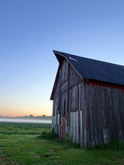 Poag Road Barn at Sunrise (Jae at Wits End) Tags: wood old morning light red sun mist plant building tree green texture abandoned nature grass architecture barn rural america sunrise outside dawn daylight early illinois am haze woods midwest alone exterior outdoor decay farm country neglected lawn structure pale steam faded forgotten american worn lone weathered discarded forsaken hazy left solitary rejected grounds turf bleached sod faint sunup daybreak outcast washedout morn firstlight edwardsville dumped castaside discolored haziness