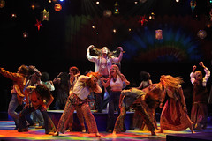 Oliver Thornton as Claude (center) and the company of HAIR, produced by Music Circus at the Wells Fargo Pavilion August 18-23, 2015. Photo by Charr Crail.