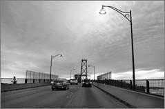 lions gate (tesseract33) Tags: world road travel bridge light sky blackandwhite art monochrome nikon lionsgatebridge roads nikondigital d300 communting nikond300 tesseract33 peterlangphotography