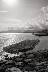 Manggis, Bali b&w (Triple_B_Photography) Tags: world ocean travel vacation bali holiday tourism beach nature weather rock stone clouds contrast canon indonesia landscape eos blackwhite seaside asia afternoon edited grain shoreline explore coastal filter journey elements 7d tropical destination indah adjustment pantai matahari candidasa karangasem
