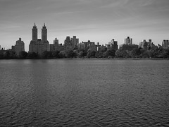 a view in bw (amysh) Tags: nyc newyorkcity bw newyork skyline centralpark jacquelinekennedyonassisreservoir eastdrive olympuse420