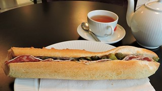 Dry sausage and cornichons in a buttered bagette; Tokyo breakfast tea