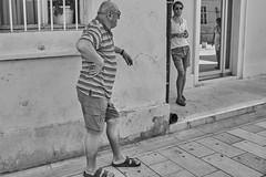 stacked (Carey Moulton) Tags: croatia street decisive moment people urban life