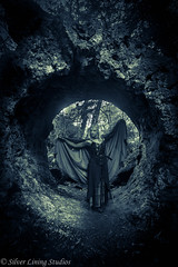 In her lair (silver lining studios) Tags: vampire vampira vampyre cloak fantasy myth magic tunnel entrance lair lotr