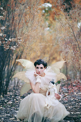 Doppelgänger (Kelly McCarthy Photography) Tags: woman model beautiful beauty conceptual doll fairy angel vintage antique wings dress crown tiara shorthair blackhair darkhair rufflecollar fairytale tale woods forest lookalike wand star makeup porcelain bokeh bokehwhores outdoors catchycolrosyellow