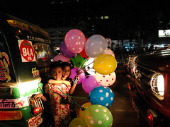 Happiness is contagious (vivid_ray) Tags: life street balloons struggle happiness smile poverty children cute adorable lovely urban balloonsseller night city light friendship