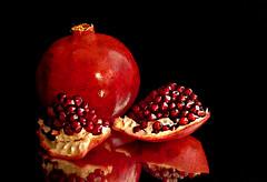 Pomegranate Still Life. (Through Serena's Lens) Tags: pomegranate fruit red garnet reflection tabletop light delicious juicy stilllife