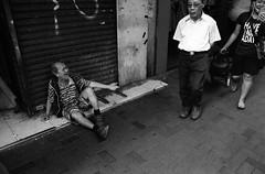 disregard... (David Davidoff) Tags: street people life human documentary sociallandscape monochrome leicaflexsl2 elmaritr28mmf28 ilfordhp5plus400 blackwhitefilm beggar humanistic haveaniceday