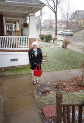 Enduring A Wet Snowfall (Laurette Victoria) Tags: december winter sidewalk mini tights coat scarf silver laurette woman purse