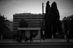 Hoping for the bus to be on time (Konstantinos Karnaros) Tags: greece athens bus stop people waiting time