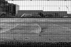 Behind Bars (Number Johnny 5) Tags: lines tamron d750 2470mm east industrial noir imanoot construction black great yarmouth anglia outdoors nikon monochrome white norfolk fence