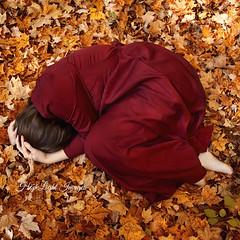 Fallen Leaf (hopelightimages) Tags: fall autumn autumnleaves orange red girl forest outdoor nature fallleaves leaves fallen broken end beginning beauty