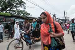 H502_1996 (bandashing) Tags: street england mobile manchester women phone walk hijab talk wires sit shops rickshaw niqab sylhet bangladesh mullah socialdocumentary aoa bandashing akhtarowaisahmed