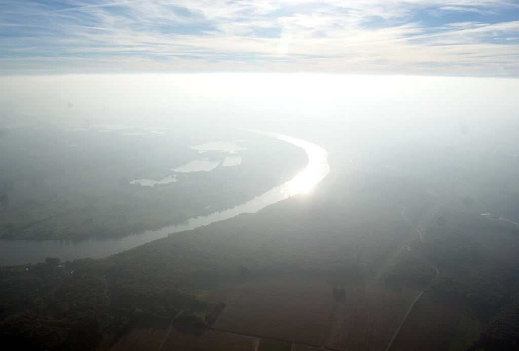 The Seine appears in the haze below as we head south-west