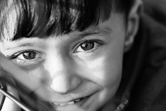 The eyes of a syrian little refugee behind a fence (Giulio Magnifico) Tags: portrait bw macro girl child refugees muslim croatia arabic syria isis syrian jihad migrants polaroidcube nikond800e nikkormicro105mmafsvrf28 da3sh