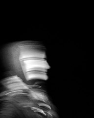 Night Stalkers v2 (Krillinator) Tags: friends light shadow portrait people blackandwhite motion black blur monochrome face night contrast dark walking outside outdoors person photography photo movement friend different faces body expression walk background coat flash ghost silhouettes surreal eerie clothes spooky identity human filter outline gesture simple ghostly humans edit iphone spook anonymity