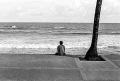Meditation (Trcio Campelo) Tags: street brazil portrait blackandwhite film beach brasil analog 35mm streetphotography ilfordhp5 bahia salvador analogue ilford bnw filmphotography yashicaelectro filmisnotdead yashicaelectro35gt buyfilmnotmegapixels