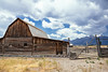 gate to the mountains (almostsummersky) Tags: log grovont johnmoultonbarn mormon homestead summer johnmoultonhomestead mormonrowhistoricdistrict grandtetons mountainrange weathered jacksonhole farm valley wood building wooden nationalpark mountains grandtetonnationalpark clouds barn abandoned gambrelbarn fence gate settlement mormonrow afternoon grosventre antelopeflats plain tetonrange sky wyoming moose unitedstates us