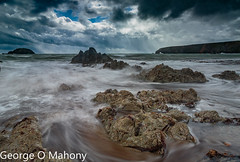 Kilfarrasy Beach 1-Explored (George O Mahony) Tags: ireland waterford kilfarrasy beach waves water stormy rocks longexposure explore explored
