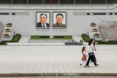 Portraits of Kim Il Sung and Kim Jung Il In the Kim Il Sung Square in Pyongyang, North Korea (DPRK) (tommcshanephotography) Tags: adventure asia communism dprk democraticpeoplesrepublicofkorea expedition exploring kimilsung kimjungil kimjungun northkorea pyongyang revolution secretcompass travel trekking