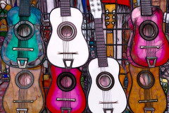 The Market - Colorful Guitars - Series 1/4 (Patti Deters) Tags: purple guitars instruments musical colorful bright forsale market sanantonio seven white pink brown teal bluegreen aqua horizontal texas internationalmarketsquare souvenirs shopping art interiordesign lobby hotel