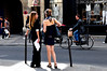 A cyclist whistling at girls on the street of Paris. ([nixon]) Tags: gilrs street sun light sunny color contrast biker crash beautifuldress beautiful city summer whistling paris france nikon d300 nikond300 prime primelens wow