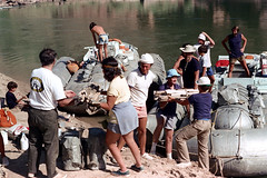 35-867 (ndpa / s. lundeen, archivist) Tags: nick dewolf nickdewolf color photographbynickdewolf 1970s 1973 1972 film 35mm 35 reel35 arizona northernarizona southwesternunitedstates canyon marblecanyon grandcanyon coloradoriver raftingtrip raftingexpedition rafting river riverrafting people beach beached raft rafts inflatable inflatables hasnderson sandersonraftingexpeditions sandersonriverexpeditions srig men women children kids loading unloading equipment woman maggie headband boys hat hats supplies scratches scratched