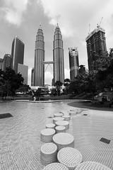 Petronas Towers (Adrian Anderson Photo) Tags: kuala lumpur monochrome street public space petronas towers tower cityscape water fountain