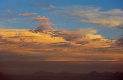 Sunset at Valley of the Moon, Atacama, Chile (Miche & Jon Rousell) Tags: chile blue sunset red southamerica argentina yellow rock clouds desert atacama andes goldenhour sanpedrodeatacama cordilleradelasal atacamadesert