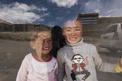 Cute Kids (Ravikanth K) Tags: 500px leh ladakh people travel india jammuandkashmir kids glass reflection window smile cute happy