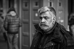 So Near Yet So Far Away (Leanne Boulton) Tags: people monochrome depthoffield urban street candid portrait portraiture streetphotography candidstreetphotography candidportrait streetportrait streetlife man male face facial expression look feeling emotion atmosphere mood concentration watching grey beard hirsute distant tone texture detail bokeh natural outdoor light shade shadow city scene human life living humanity society culture canon 5d canon5dmarkiii 70mm character ef2470mmf28liiusm black white blackwhite bw mono blackandwhite glasgow scotland uk