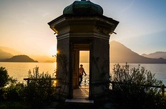 sunset at the lake garden. (lucafabbricesena) Tags: sunset lake garden varenna lombardia italia italy villamonastero temple sunbeam lagocomo reflection building nikon d800 grass autumn