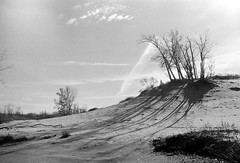 Slopes and Shadows (Georgie_grrl) Tags: princeedwardcounty cottagechoir friendship music social friends roadtrip pentaxk1000 rikenon12828mm ontario blackandwhite monochrome kentmorefilm400asa thedunesprovincialpark sand shadows trees patterns explore
