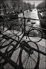 Holland - Amsterdam - Canal view_sepia_DSC3254 (Darrell Godliman) Tags: hollandamsterdamcanalviewsepiadsc3254 bikes bike bridge amsterdam holland netherlands