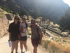 Sarah, Betsy, and Evan in Delphi, with the columns of the Temple of Apollo in the background