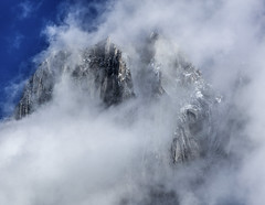 Misty Peaks (Loren Mooney) Tags: blue winter wild summer white mist snow canada mountains nature fog canon landscape rockies rocks bc natural britishcolumbia alpine wilderness peaks purcell cmh canadianrockies bugaboos purcellmountains
