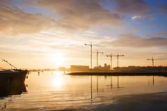 Sunrise (Jeroenc71) Tags: sunrise houthavens amsterdam ship water sunlight sun clouds sky crane construction boat