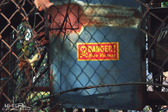 High Voltage (Hi-Fi Fotos) Tags: danger highvoltage sign electric electricity warning rusty chainlink fence shadow skull crossbones red yellow nikon d5000 hififotos hallewell
